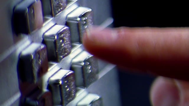 Extreme close up rack focus man's fingers dialing on pay phone / Toronto