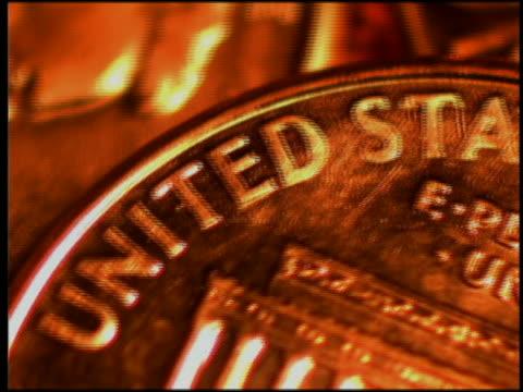 extreme close up rapidly spinning pennies - begehren stock-videos und b-roll-filmmaterial