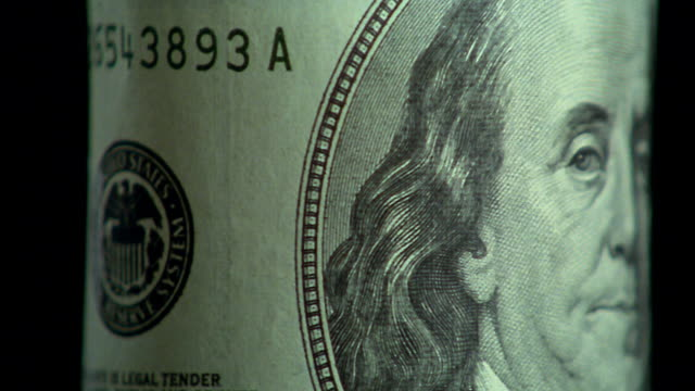 extreme close up rotating $100 bill with benjamin franklin portrait - benjamin franklin stock videos & royalty-free footage