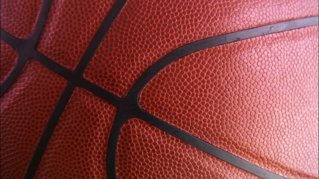 extreme close up rotating basketball - basketball ball stock videos & royalty-free footage