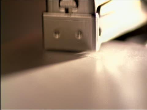 extreme close up stapler stapling paper - ホッチキス点の映像素材/bロール