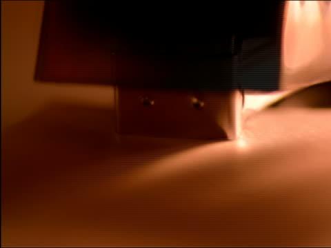 vidéos et rushes de orange extreme close up stapler stapling paper - objet en papier