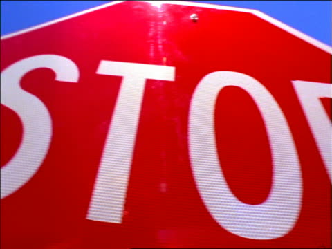 "extreme close up pan ""stop"" sign / new mexico - octagon stock videos and b-roll footage"