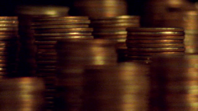 extreme close up time lapse stacks of coins magically decreasing in size