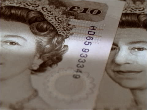 extreme close up tracking shot over british ten pound note - currency stock videos & royalty-free footage