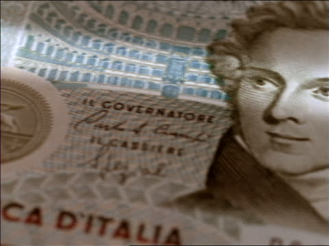 extreme close up tracking shot over italian lira - financial accessory stock videos & royalty-free footage