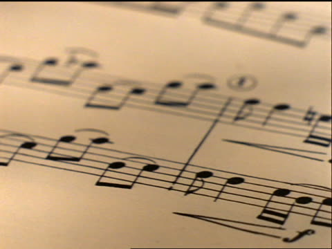 extreme close up tracking shot over sheet music - musical symbol stock videos & royalty-free footage