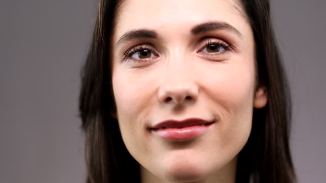 extreme close up view of a beautiful woman's face. - mid adult stock videos & royalty-free footage