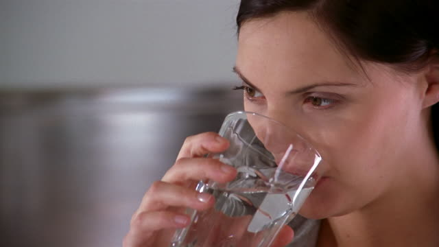 Extreme close up woman drinking glass of water / Brussels, Belgium