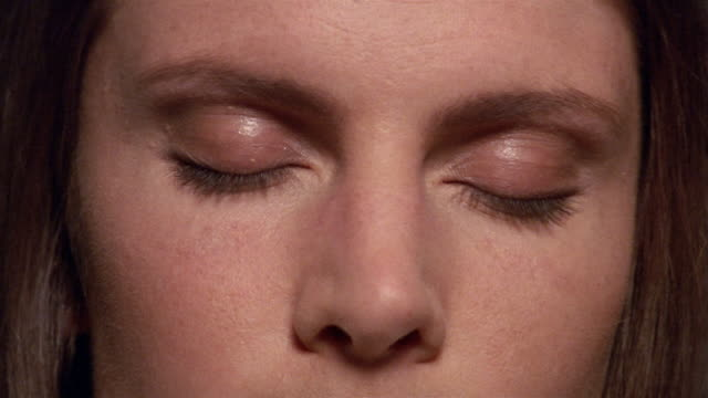 extreme close up woman opening her eyes - augen geschlossen stock-videos und b-roll-filmmaterial