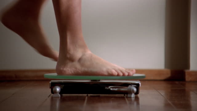 extreme close up woman's feet stepping onto scale / stepping off / brussels, belgium - weight scale stock videos & royalty-free footage