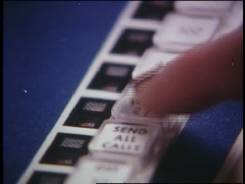 1970 extreme close up woman's fingers pushing telephone buttons