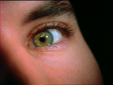 extreme close up woman's green eye turning towards camera - green eyes stock videos and b-roll footage