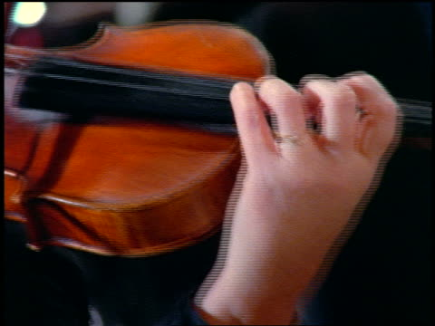 extreme close up woman's hand playing violin - violin stock videos & royalty-free footage