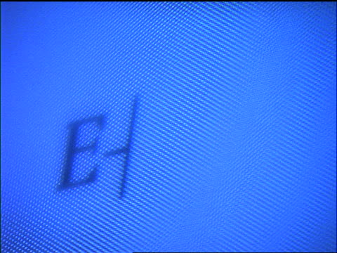 """extreme close up word """"E-mail"""" typing out on blue computer screen"""