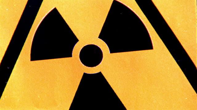 Extreme close up yellow and black radiation warning sign flashing / New York City