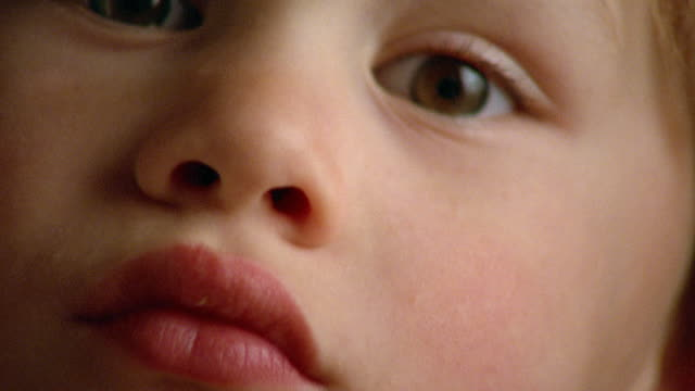 vidéos et rushes de extreme close up young boy smiling - tout petit