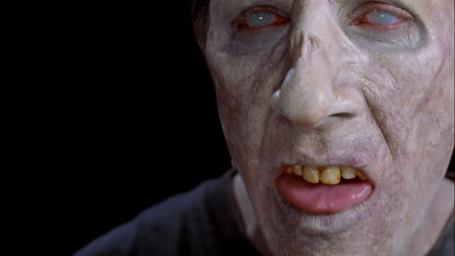 extreme close up zombie looking at camera / grimacing - zombie stock videos & royalty-free footage