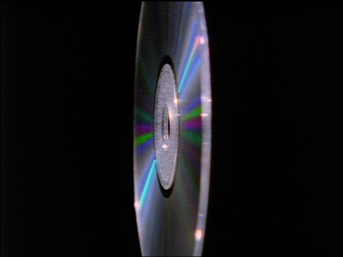 stockvideo's en b-roll-footage met extreme close up zoom in + zoom out compact disc turning / black background - 1998