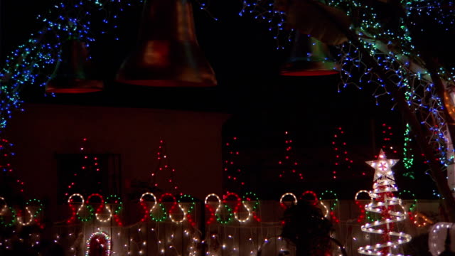 extreme close up zoom in zoom out pan christmas lights and decorations / night / california - swish pan stock videos & royalty-free footage