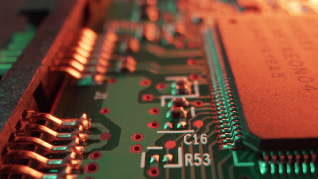 vidéos et rushes de extreme close-up artistique unique macro moving slider flyover shot of sata and power connector pins for computer chips and circuits on a hard disk drive from a computer or server or security or bitcoin mining system under bright neon colored lighting extr - cable