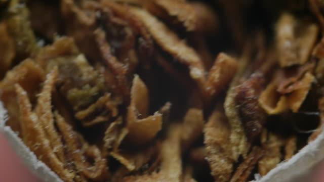 Extreme close-up, cigarette.