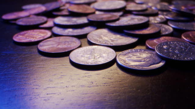 extreme close-up macro moving slider shot of american currency coins - obsolete stock videos & royalty-free footage