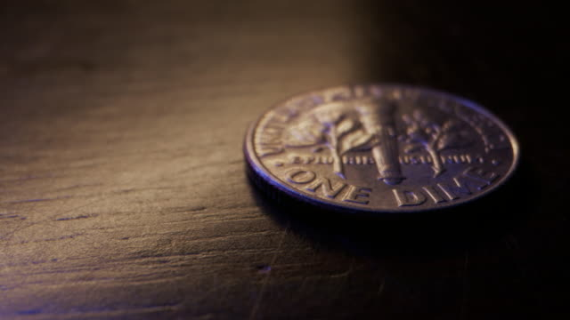 stockvideo's en b-roll-footage met extreme close-up macro moving slider shot van de achterkant van een amerikaanse valuta dubbeltje - samenzwering