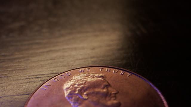 extreme close-up macro moving slider shot of the top heads side of an american currency penny worth one cent - coin stock videos & royalty-free footage