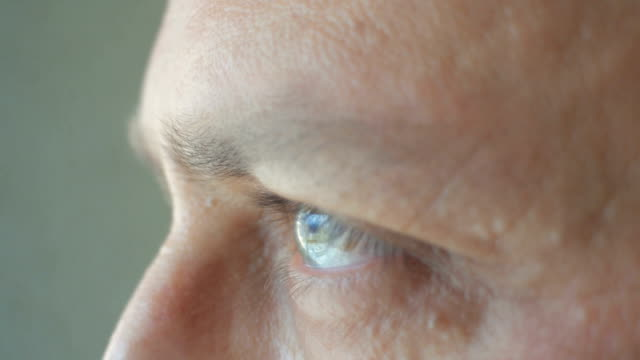 extreme close-up of a man's eye looking away - man blinking stock videos & royalty-free footage