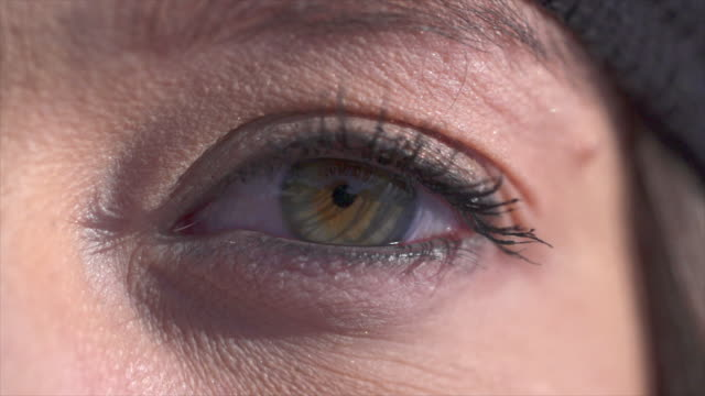 extreme close-up of a woman eye blinking. - sci attrezzatura sportiva video stock e b–roll