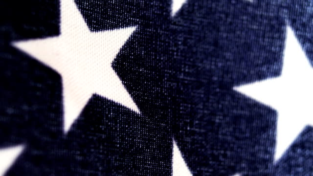 extreme close-up of an american flag - stars and stripes stock videos & royalty-free footage