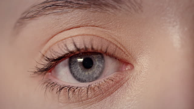 extreme close-up of blue human eye - blinking stock videos & royalty-free footage