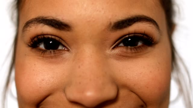 extreme close-up of happy woman with brown eyes - females stock videos & royalty-free footage