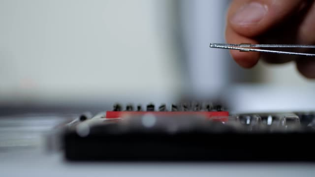 extreme close-up of instruments. dolly shot of a screwdriver bit set, hands preparing for work, red color, toolbox set - toolbox stock videos and b-roll footage