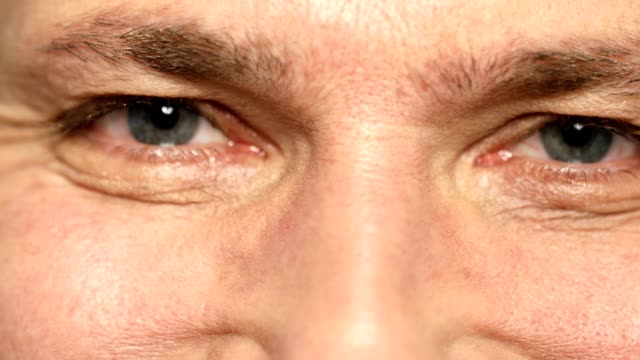 extreme close-up of mature man with gray eyes - man blinking stock videos & royalty-free footage