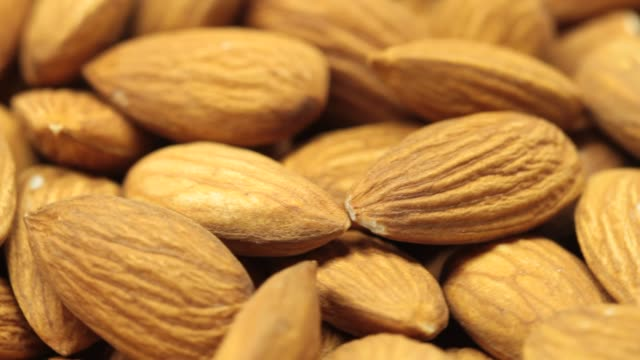 extreme close-up of nuts - almond stock videos & royalty-free footage
