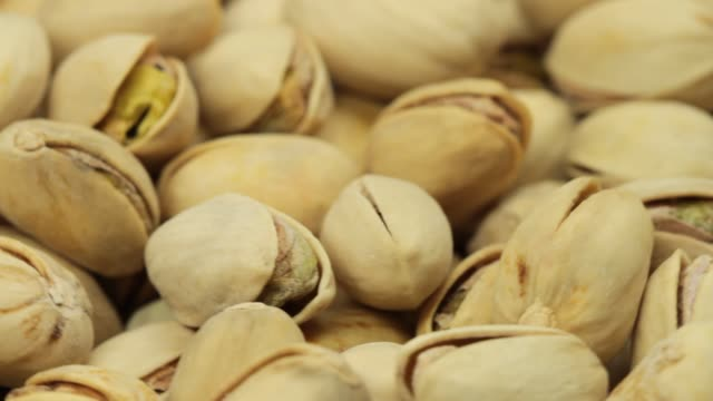 extreme close-up of nuts - pistachio nut stock videos & royalty-free footage