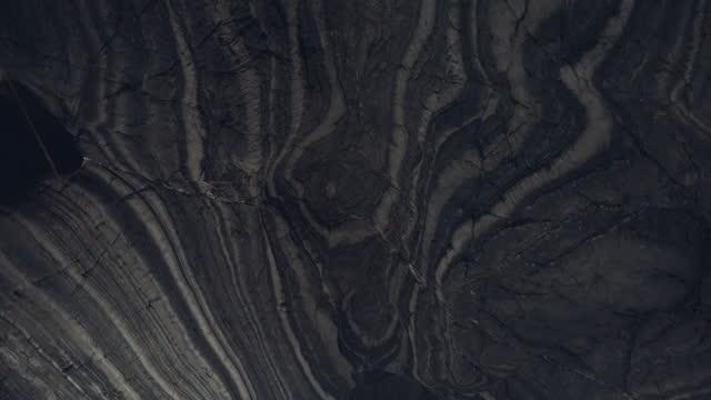 vidéos et rushes de plan rapproché extrême de roche texturé - caillou