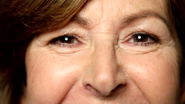 extreme close-up of senior woman with brown eyes - extreme close up stock videos & royalty-free footage