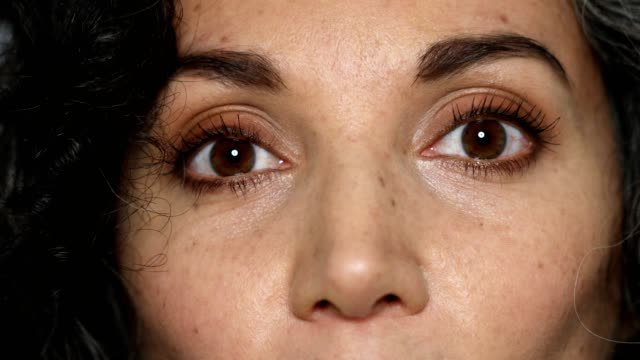 extreme close-up of woman with brown eyes - human eye stock videos & royalty-free footage
