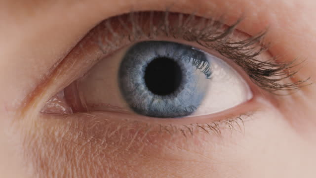 extreme close-up of young woman with gray eyes - close up stock videos & royalty-free footage