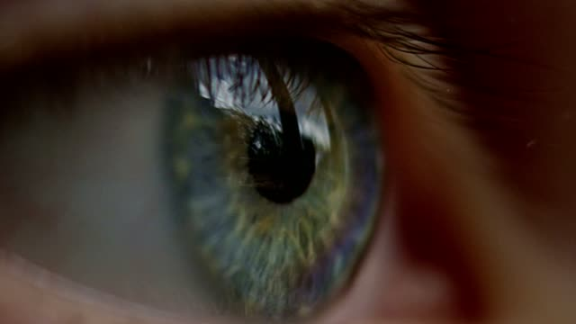 extreme closeup on blue and green human eye - staring stock videos & royalty-free footage