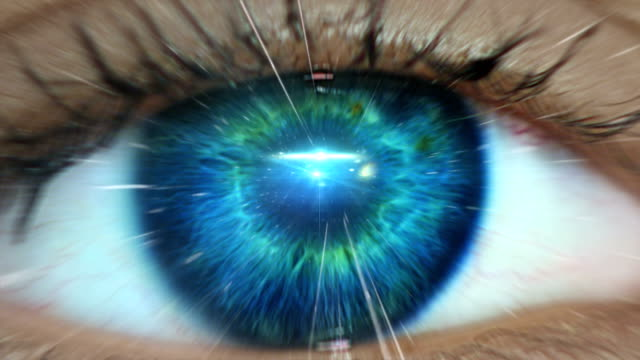 extreme closeup on blue eye. entering human mind - star space stock videos & royalty-free footage