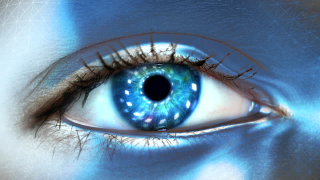 extreme closeup on blue eye of android. entering artificial intelligence - artificial intelligence stock videos & royalty-free footage