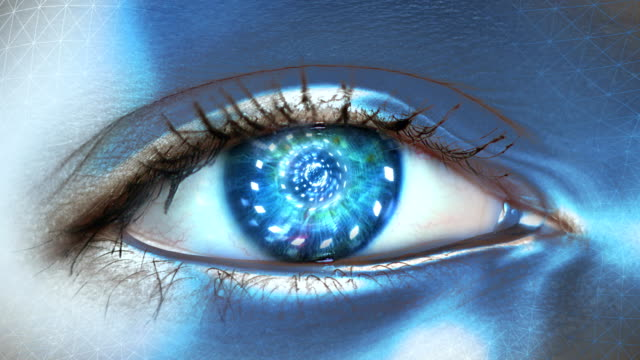 extreme closeup on blue eye of android. entering artificial intelligence - human age stock videos & royalty-free footage