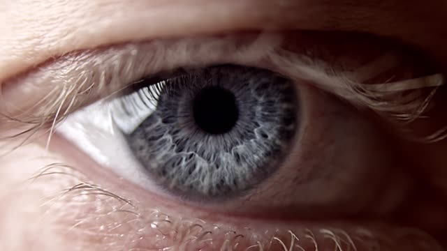 extreme closeup on blue human eye - eye stock videos & royalty-free footage