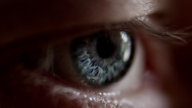 extreme closeup on blue human eye - staring stock videos & royalty-free footage