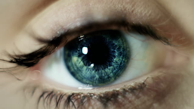 extreme closeup on blue human eye - blinking stock videos & royalty-free footage