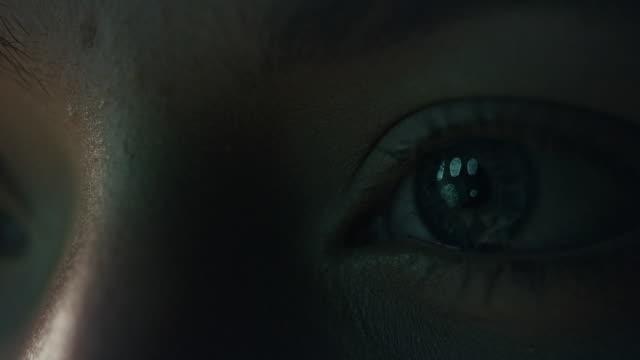 extreme closeup on blue human eye - vicino video stock e b–roll